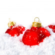 Christmas holiday decoration with white snow and red bowls — Stockfoto