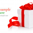 Gift with red bow and ribbon — Stock Photo