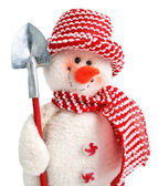 Smiling snowman toy with shovel — Stock Photo