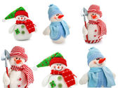 Smiling snowman toy dressed in scarf and cap — Stock Photo