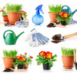 Set garden grass and flowers in the pots — Stock Photo #6590335