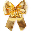 Gold glossy bow isolated on white — Stock Photo