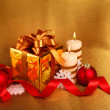 Christmas gift in gold box with bow — Stock Photo