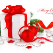Christmas gift with red balls and branch firtree — Stock Photo