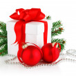 Christmas gift with red balls and branch firtree — Stock Photo #6593463