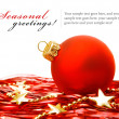 Christmas holiday decoration with red bowl and gold stars — Stockfoto