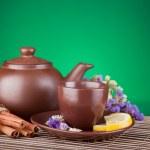 Ceramic teapot with tea — Stock Photo