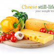 Yellow cheese with fresh vegetables — ストック写真
