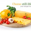 Foto Stock: Yellow cheese with fresh vegetables