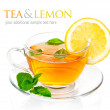 Tea in cup with leaf mint and lemon — Stock Photo