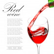 Red wine pouring into glass — Stock Photo