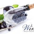 Wine bottle with glass and grapes — Stock Photo #6596156