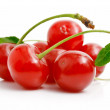 Royalty-Free Stock Photo: Fresh red cherries with green leaves