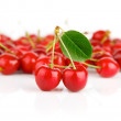 Fresh cherry fruits with green leaves — Stock Photo #6597773