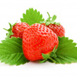Red strawberry fruits with green leaves — Stock Photo #6598104