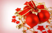Christmas background with red balls and stars — Stock fotografie