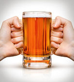 Competition of two hands with beer in glass — Stock Photo