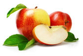 Red apple fruits with cut and green leaves — Stock Photo