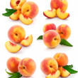 Set fresh peach fruits with green leaves — Stock Photo