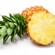 Fresh pineapple fruits with cut and green leaves — Stock Photo #6609153