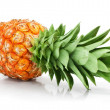 Fresh pineapple fruit with cut and green leaves — Stock Photo #6609159