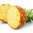 Fresh pineapple fruit with cut and green leaves — Stock Photo #6609184