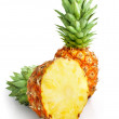Fresh pineapple fruit with cut and green leaves — Stock fotografie