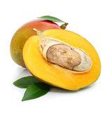 Fresh mango fruit with green leafs — Stock Photo