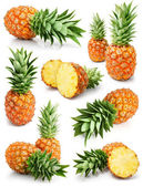 Fresh pineapple fruits with cut and green leaves — Stock Photo
