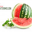 Juicy watermelon in cut with green leaf - Stok fotoğraf