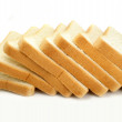 Fresh cut bread on white background — Stock Photo