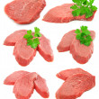 Collection of sliced meat with green parsley leafs - Foto Stock