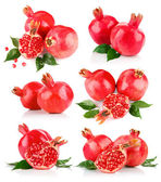Set pomegranate fruits with cut and green leaf — Stock Photo