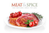 Raw meat with spice on plate — Stock Photo