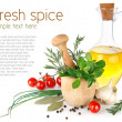 Fresh spices with vegetables and olive oil — Stock Photo