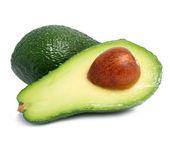 Fresh green avocado fruits isolated on white — Stock Photo