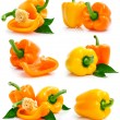 Set of fresh yellow orange peppers with green leaves — Stock Photo #6631422