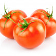 Fresh red tomatoes with green leaf isolated — Stock Photo #6634221