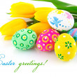 Stock Photo: Easter eggs with yellow tulip flowers