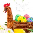 Easter eggs in basket with yellow tulip flowers — Stock Photo #6635399