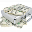 Stock Photo: Packs of dollars money on the silver suitcase