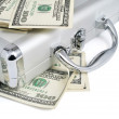 Packs of dollars money on the silver suitcase - Stock Photo