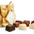 Sweet chocolate candies with box isolated — Stock Photo