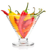 Pepper vegetable fruits in glass vase isolated — Stock Photo