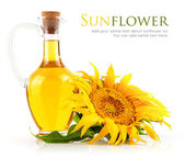 Sunflower oil with flower — Stock Photo