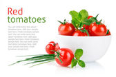 Fresh tomatoes with green leaf — Stock Photo