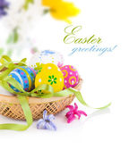 Easter eggs in basket with bow — Stok fotoğraf