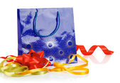 Gift bag with bow and ribbons — Stock Photo