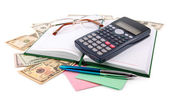 Notebook with pen and calculator isolated on white — Stock Photo