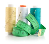 Color threads with needles and green measuring line — Stock Photo